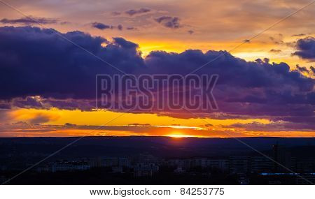 Cumulus Clouds At Sunset Over The City.