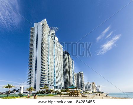People Relax Near The Pier In Sunny Isles Beach