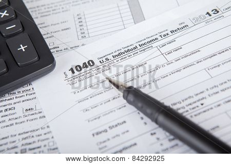 Pen With Tax Form And Calculator