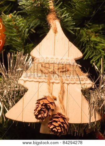 Woodden Fir Decoration On Christmas Tree With Pine Cone