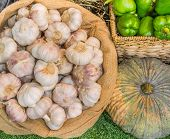 close up shot of garlic pumpkin and chili in basket image. poster