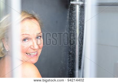 Smiling Attractive Senior Woman Taking A Shower
