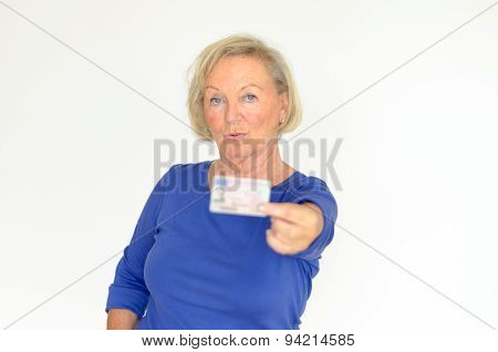 Senior Lady Holding Out Her Driver´s License