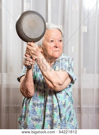 Angry Old Woman With A Pan