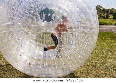 Child Has Fun In The  Ball