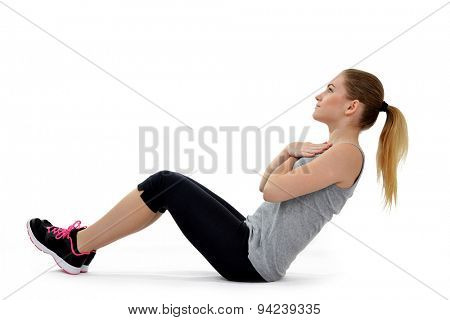 Girl exercising workout fitness aerobic exercise abdominal push ups posture on studio isolated