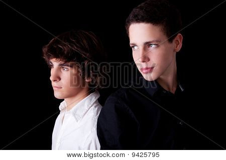 Two Young Back To Back, Isolated On Black, Studio Shot