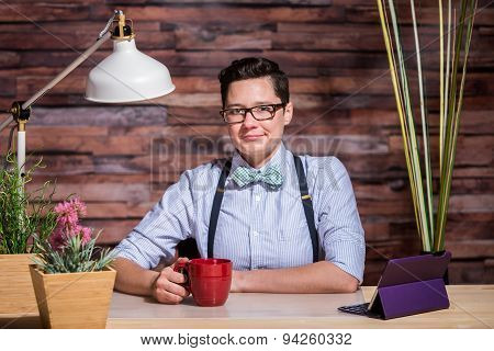 Dapper Woman In Stylish Office At Wood Desk With Mug