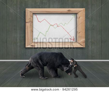 Businessman Fighting Against Bear With Trend Lines Whiteboard