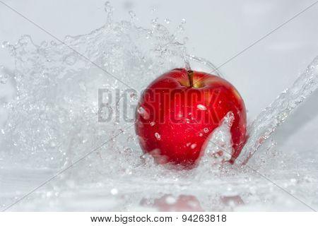 Red Apple In Water Splashing
