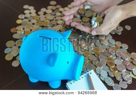 Man Hand Earn Money From Saving In Piggy Bank