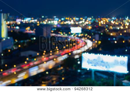 Blur bokeh city freeway curve at night