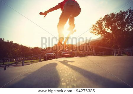 skateboarder legs doing a trick ollie at skatepark poster