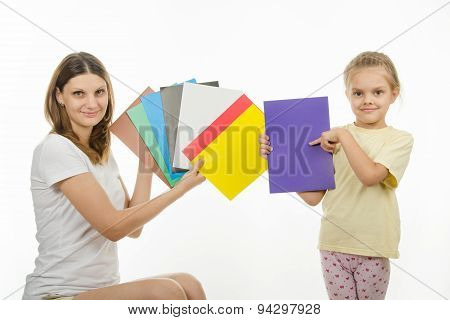 Girl And Girl Are Holding Colorful Monochrome Images