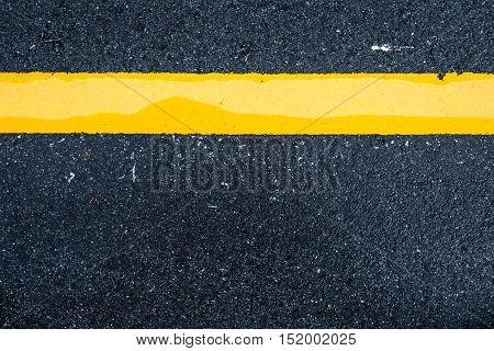 Asphalt road background with traffic line-close up