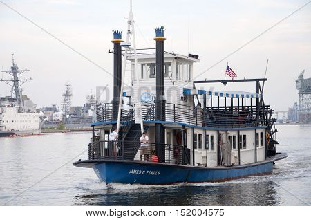 NORFOLK, VA, USA - MAY 4: Steamboat operated by Hampton Roads Transit (HRT) connects downtown Norfolk to Old Town Portsmouth across Elizabeth River on May 4th, 2012 in Norfolk, Virginia, USA.