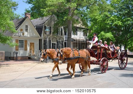 WILLIAMSBURG, VA, USA - MAY 7, 2012: Horse drawn carriage tours in British Colony in Williamsburg, Virginia, USA.