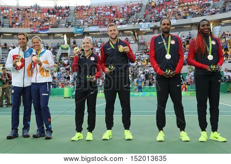 RIO DE JANEIRO, BRAZIL - AUGUST 14, 2016:Team Czech (L), team USA Mattek-Sands and Sock and Team USA Ram V.Williams during medal ceremony after tennis mixed doubles final of the Rio 2016 Olympic Games