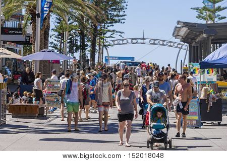 Gold Coast, Australia - September 22, 2016: View of many tourists walking along Cavill Avenue, the busiest street located in the heart of the Surfers Paradise shopping and entertainment precinct.