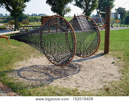Fun time with creative play net in a playground