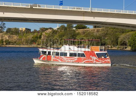 Brisbane, Australia - September 23, 2016: People onboard the free CityHopper ferry in Brisbane during daytime. The ferry service is free and runs along the Brisbane River.