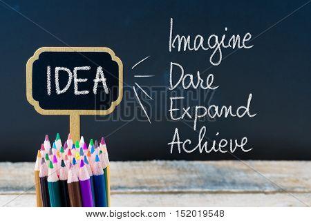 Business Acronym Idea Imagine Dare Expand Achieve Written With Chalk On Wooden Mini Blackboard Label