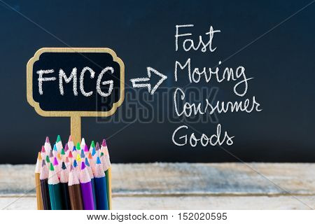 Business Acronym Fmcg Fast Moving Consumer Goods Written With Chalk On Wooden Mini Blackboard Labels