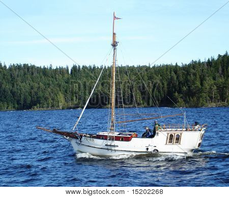 Awash small old boat like Peter the Great time.Ladoga.Russia poster
