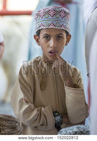 Nizwa Oman October 13th 2016: Omani child in Nizwa goat market
