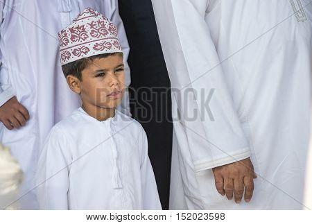 Nizwa Oman October 13th 2016: young Omani boy at a goat market