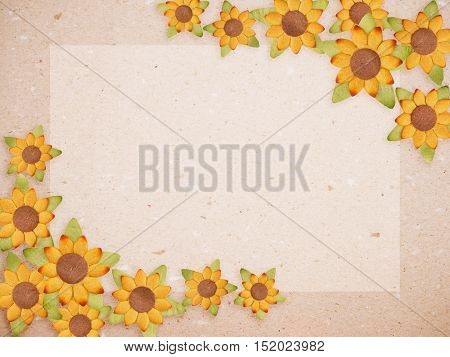 Recycled paper card with yellow artificial sunflower flower