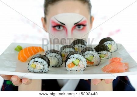 Beautiful Japan Geisha Woman With Creative Make-up And Sushi Roll Set