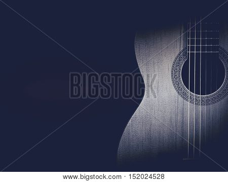 Part of a blue acoustic guitar on black background
