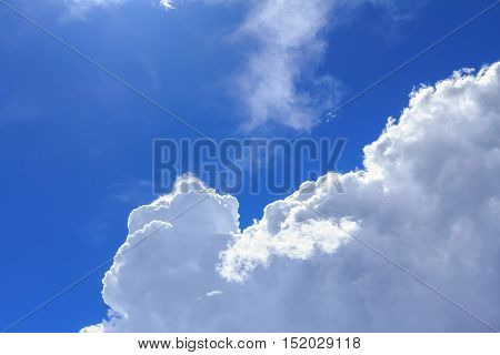 Blue sky with white clouds and rain clouds. The vast blue sky and clouds sky on sunny day. White fluffy clouds in the blue sky.