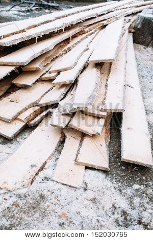 Bunch of boards covered with snow texture. Frosted wooden planks left outside in winter. Cold, early frosts, hoar concept
