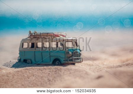 Vintage miniature van in vintage color tone travel concept