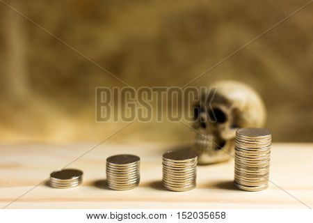 Still Life.staircase Of Money, Thai Coins Of One Bath On Wood And Skull Background.concept Of Financ