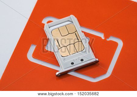 Nano sim card with sim tray and sim card adapter on white background