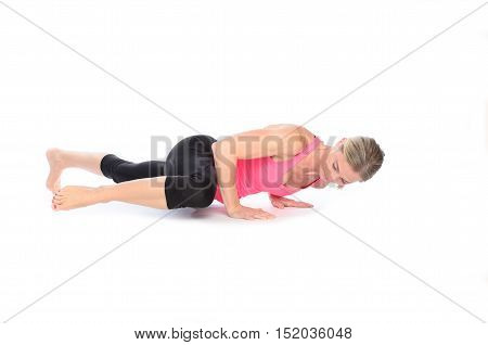 Woman Doing Abdominal And Thigh Muscle Exercises