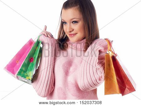 Young attractive woman smiles with bags after shopping over isolated background
