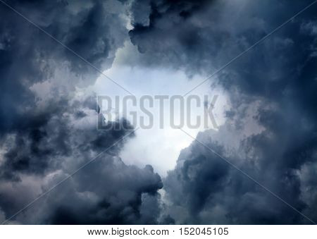 Hole of the Sky in the Dark Storm Clouds