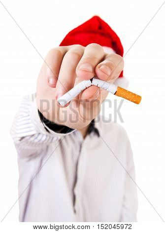 Person in Santa Hat with broken Cigarette in a Hand closeup on the White Background