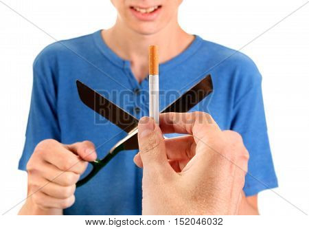 Teenager Destroy a Cigarette with Scissors Isolated on the White Background