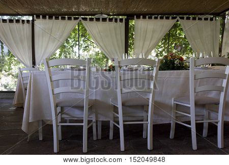 FLORENCE, ITALY - MAY 21 2016: Close up of the set up for a wedding of a restaurant on the Florentine hills Italy