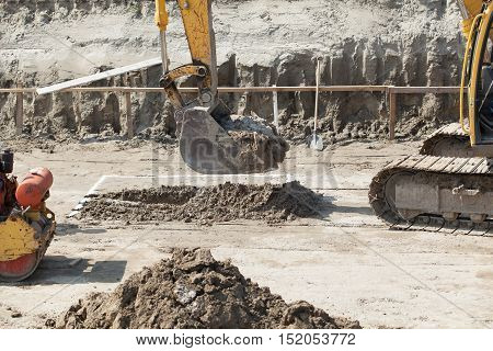 Excavator digger on a building site. Earthwork at construction site.