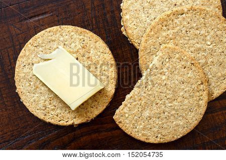 Scottish Oatcakes With A Slice Of Yellow Cheese On Woden Desk From Above.