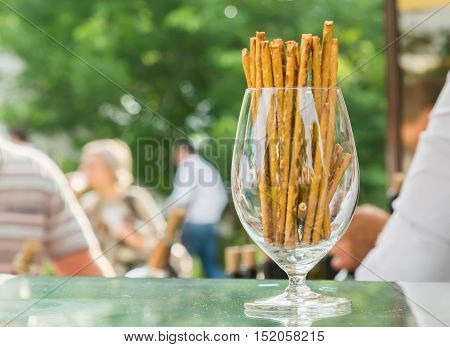 the bread sticks with sesame in a glass
