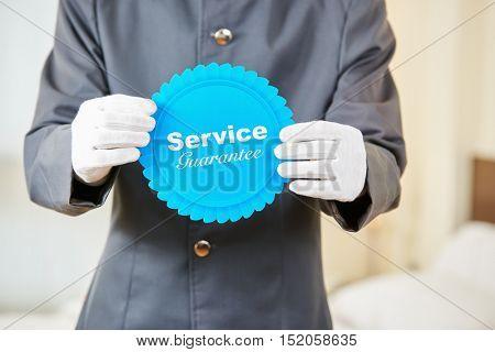 Service guarantee badge in a hotel room