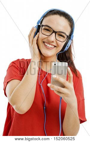 Happy woman listen music on her phone, isolated over white background