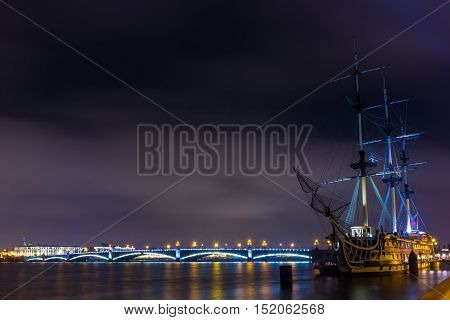 Frigate Grace at twilight illumination, St. Petersburg, Russia poster